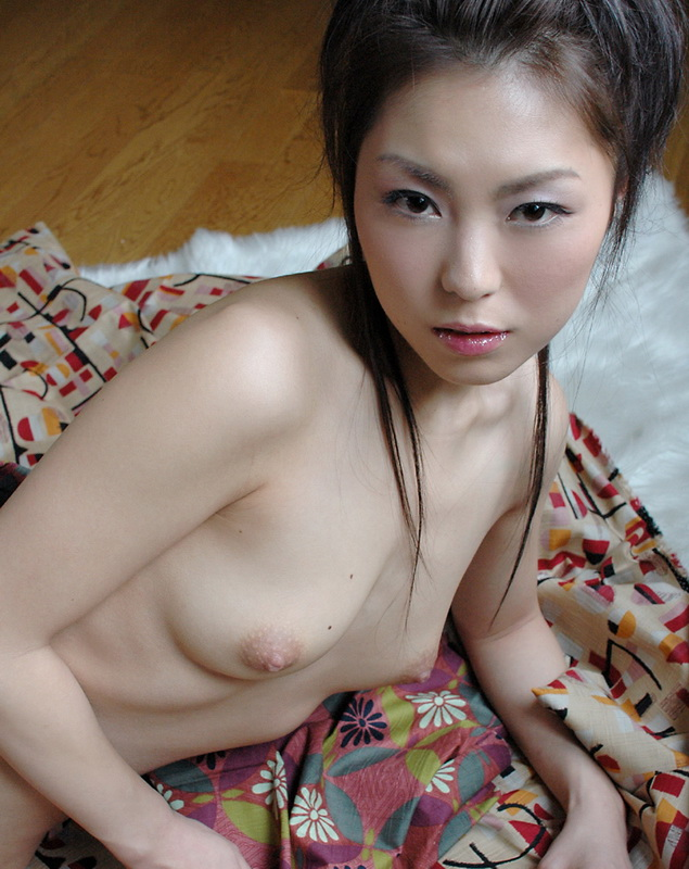 Nude selfshot sitting on bed