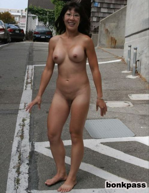 Naked woman with hands tied behind back