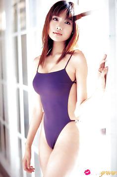 Eriko Sato looking sexy in her bikinis