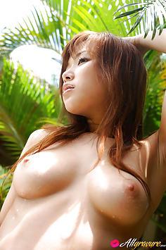 Yua Aida showing her busty Japanese tits