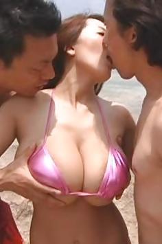 Busty Japanese pornstar Hitomi Tanaka takes on 2 cocks