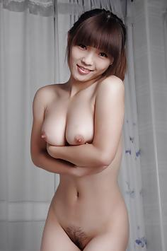 Young nude Chinese girl with perfect tits